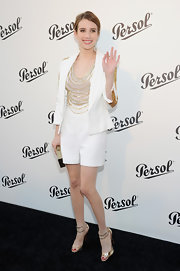Emma Roberts stunned in a contemporary, white tweed playsuit that featured a chain-embellished neckline.