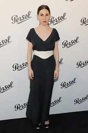 Zosia Mamet opted for a classic black jumpsuit with wide legs and a draped V-neck while at the Persol Magnificent Obsessions Event.