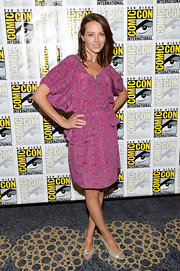 Amy Acker's fuchsia-colored draped dress featured a peplum detail.