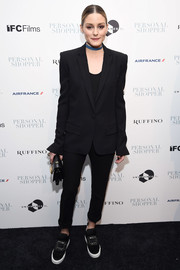 Olivia Palermo styled her suit with a pair of bejeweled satin slip-ons by Roger Vivier.