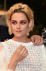 Kristen Stewart attended the Cannes Film Festival screening of 'Personal Shopper' wearing layers of diamond rings.