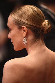 Chloe Sevigny slicked her hair back into a tight twisted bun for the Cannes premiere of 'Personal Shopper.'