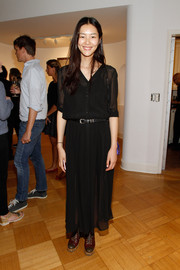 Liu Wen kept it breezy in a sheer black shirtdress during the Peter Lindbergh exhibition.