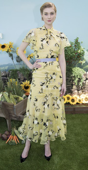 Elizabeth Debicki went for an ultra-feminine vibe in a yellow Erdem floral dress with flutter sleeves at the Australian premiere of 'Peter Rabbit.'