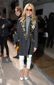 Dani opted for winter white pumps at the Peter Som show in NYC.