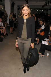 Olivia paired her classic tweed blazer with a leather Onie Messenger bag.