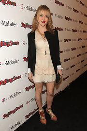 Taryn pairs her tough blazer with a cream cocktail dress at the Rolling Stone Awards.