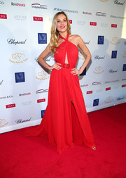 Petra Nemcova was sexy-glam in a red halter gown with a peekaboo front at the 2017 Graduation Gala.