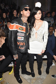 Kylie Jenner toughened up her look with black thigh-high boots by Philipp Plein.