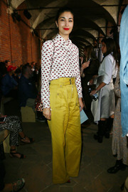Caroline Issa attended the Philosophy di Lorenzo Serafini fashion show looking cute in a lip-print blouse.