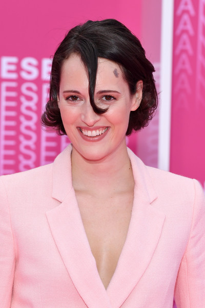 Phoebe Waller-Bridge Bob [killing eve,hair,pink,eyebrow,skin,hairstyle,chin,lip,forehead,smile,premiere,pink carpet arrivals,phoebe waller-bridge,when heroes fly,serie,cannes,france,1st cannes international series festival,palais des festivals,screening]