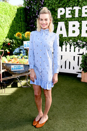 Margot Robbie was casual and cute in a rabbit-print mini dress by Gucci at the photocall for 'Peter Rabbit.'