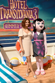 Selena Gomez looked airy in a beaded nude mini dress by Miu Miu at the 'Hotel Transylvania 3' photocall.