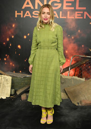 Piper Perabo kept it modest yet stylish in a long-sleeve green midi dress at the photocall for 'Angel Has Fallen.'