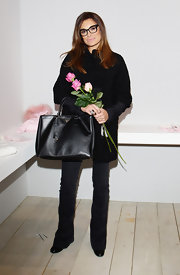 Alena Seredova carried her favorite arm candy brand, Prada, during an I Pinco Pallino presentation in Florence, Italy.