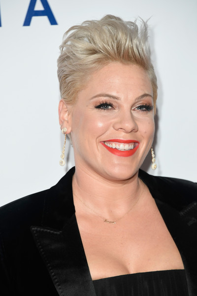 Pink Fauxhawk [hair,face,hairstyle,blond,facial expression,eyebrow,lip,chin,forehead,beauty,musicares person of the year,los angeles convention center,california,dolly parton,arrivals,p nk]