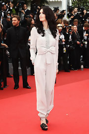 Paz took a unique approach to the Cannes red carpet in a bowed jumpsuit.