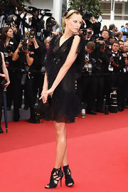 Karolina Kurkova gave her feathered Chanel dress an edge with black suede and metallic cage cage sandals.
