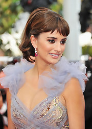 Penelope Cruz strolled the red carpet at the Cannes Film Festival wearing ruby earrings set in 18-karat white gold.