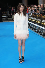 Astrid was a feathered beauty in a unique white zip-up dress at the 'Pirates of the Caribbean' UK premiere.