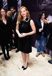 Jessica Chastain opted for a demure little black dress with a white-trimmed collar when she attended the Pirelli Calendar event.