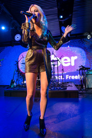 Pixie Lott gave a dazzling performance wearing a gold wraparound romper by Diane Von Furstenberg during her album launch.