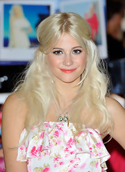 Pixie Lott paired her flawless look with a swipe of coral lipstick.
