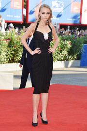 Lily-Rose Depp looked very mature in a black Chanel halter dress with a draped skirt and bow detailing during the Venice Film Festival premiere of 'Planetarium.'
