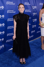 Julianne Moore was modest yet stylish in a high-neck black knit gown by Valentino at the Planned Parenthood 100th anniversary gala.