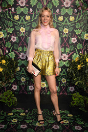 For her bag, Chloe Sevigny chose a two-tone envelope clutch by Prada.