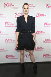 Evan Rachel Wood amped up the edge with black lace-up boots by Giuseppe Zanotti.