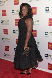 Uzo Aduba arrived for the Point Honors Gala carrying an elegant beaded clutch.