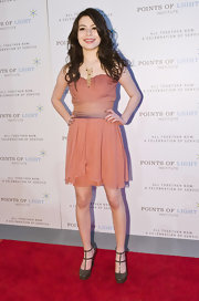 Miranda Cosgrove accented her girlish peach frock with olive patent pumps with double ankle straps.