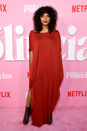 Indya Moore styled her frock with brown ankle boots.