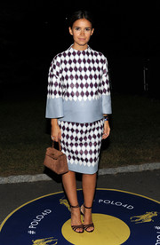 Miroslava Duma sealed off her perfectly-put-together ensemble with a tan suede purse by Hermes.