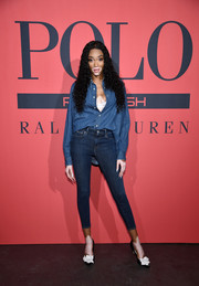Winnie Harlow sported a half-unbuttoned denim shirt at the Polo Red Rush launch party.