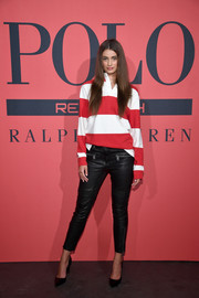 Taylor Hill rounded out her stylish look with black leather pants.