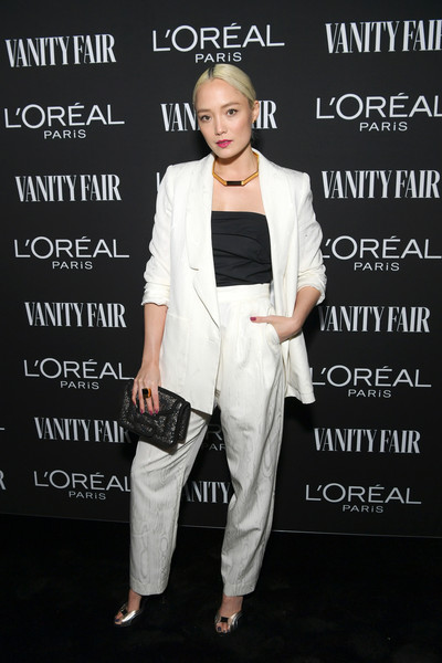 Pom Klementieff Metallic Clutch [vanity fair,lor\u00e9al paris celebrate new hollywood,al paris celebrate new hollywood,pom klementieff,lor\u00e3,white,clothing,suit,fashion,pantsuit,shoulder,footwear,formal wear,outerwear,shoe,california,los angeles]