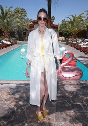 Whitney Port wore a white duster over a striped yellow one-piece while visiting the Sparrows Lodge.