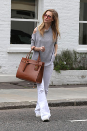 Poppy Delevingne was spotted out in London wearing a gray cold-shoulder turtleneck.