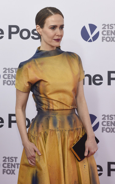 Sarah Paulson paired a dark burgundy velvet clutch with a tie dye-effect dress for the Washington, DC premiere of 'The Post.'