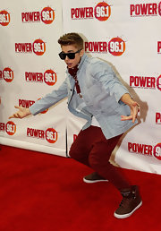 Justin Bieber struck a pose in a pair of brown leather sneakers.