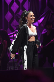 Demi Lovato showed some skin in a white sports bra while performing at Power 96.1's Jingle Ball 2017.