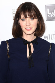 Zooey Deschanel looked sweet and girly with her bob and wispy bangs at the Power of Food event.