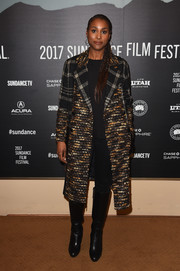 Issa Rae finished off her attire with a pair of black knee-high boots.