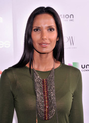 Padma Lakshmi spruced up her simple dress with an eye-catching beaded statement necklace.