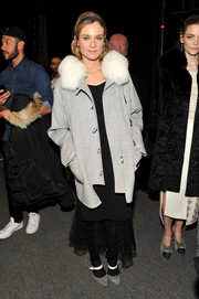 Diane Kruger matched her coat with a pair of gray and white Mary Jane pumps.