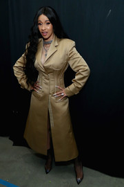 Cardi B rocked a fitted khaki trenchcoat by Prabal Gurung during the label's Fall 2018 show.