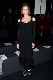 Diane Kruger graced the Prabal Gurung fashion show wearing not one but two dresses from the label: a ribbed black off-the-shoulder sweater dress layered over a lacy sleeveless LBD.