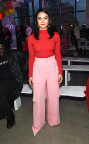 Camila Mendes covered up in a red turtleneck by Prabal Gurung for the brand's Spring 2019 show.